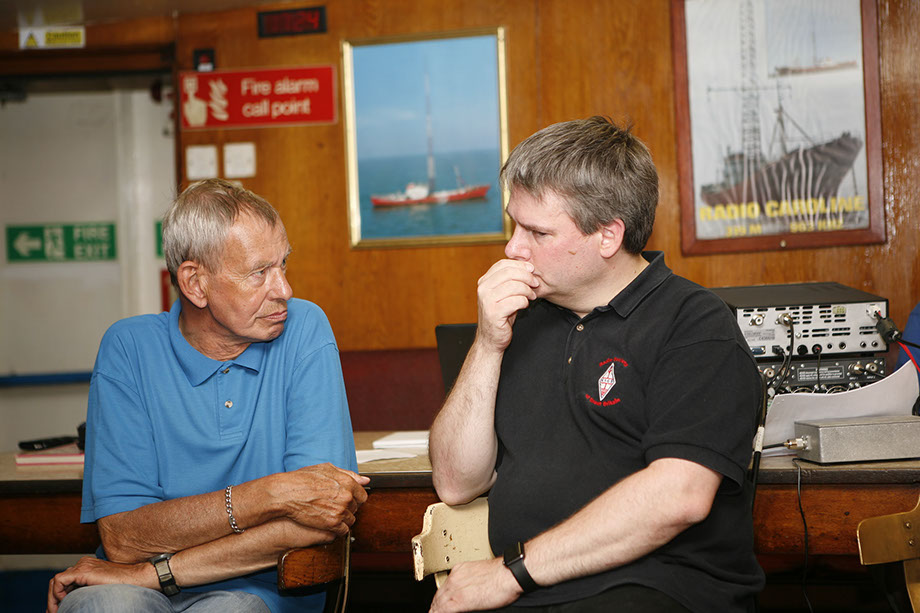 Bill Rollins, G1WJR and Pete Sipple, M0PSX chatting in the mess of MV Ross Revenge.